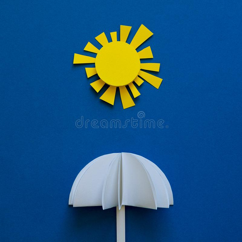 Paper umbrellas under sun. Origami. Sun protection and summer vacation concept.  stock image