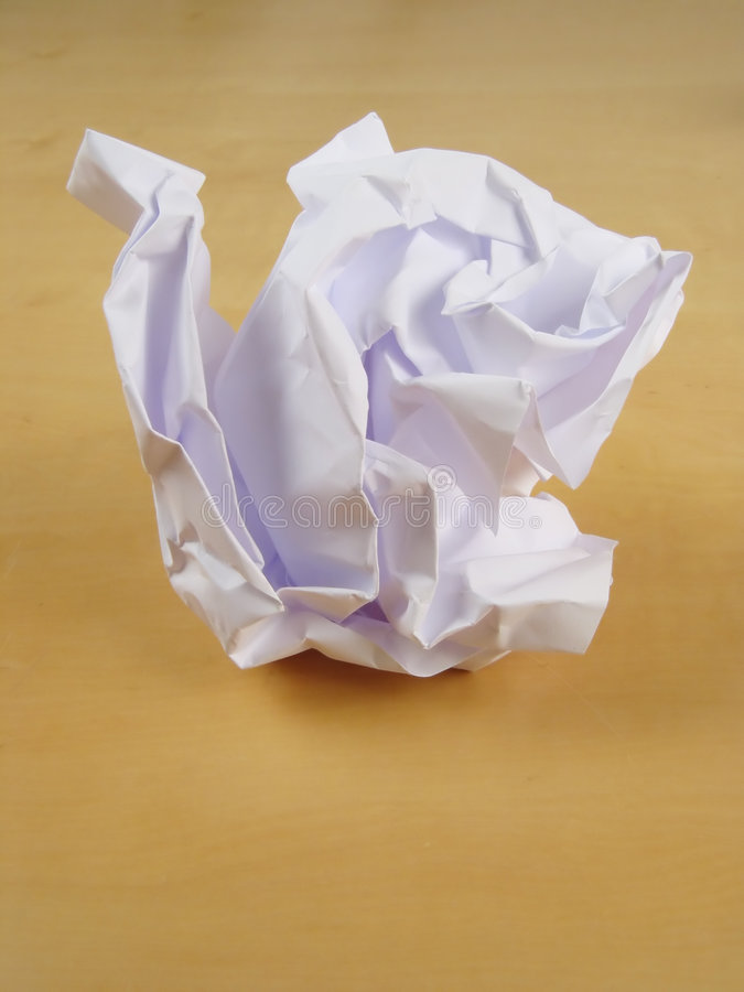 Paper Wad On Desk Stock Image