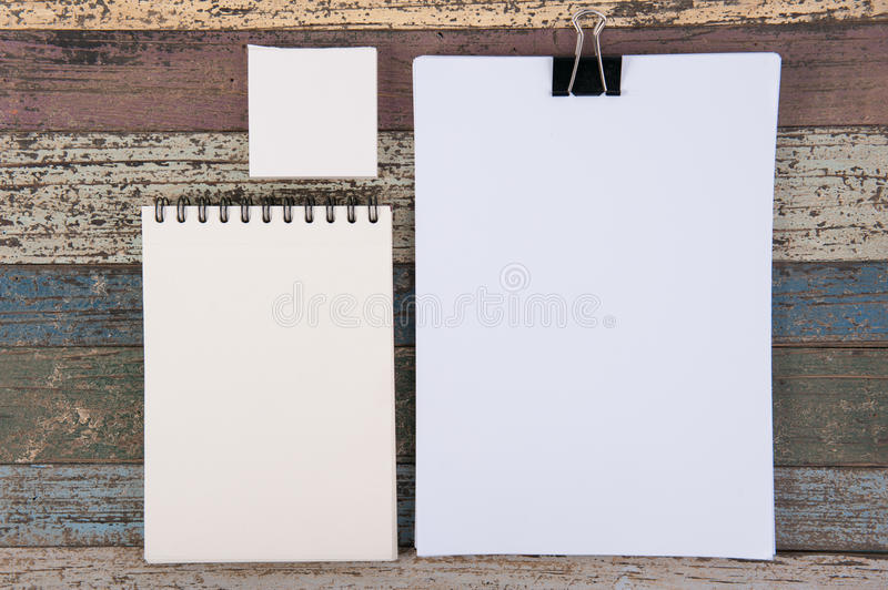 Paper white notebook for work and art on vintage wood for background royalty free stock images