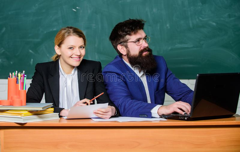 Paper work. office life. back to school. formal education. businessman and happy secretary. business couple use laptop. And documents. teacher and student on royalty free stock image