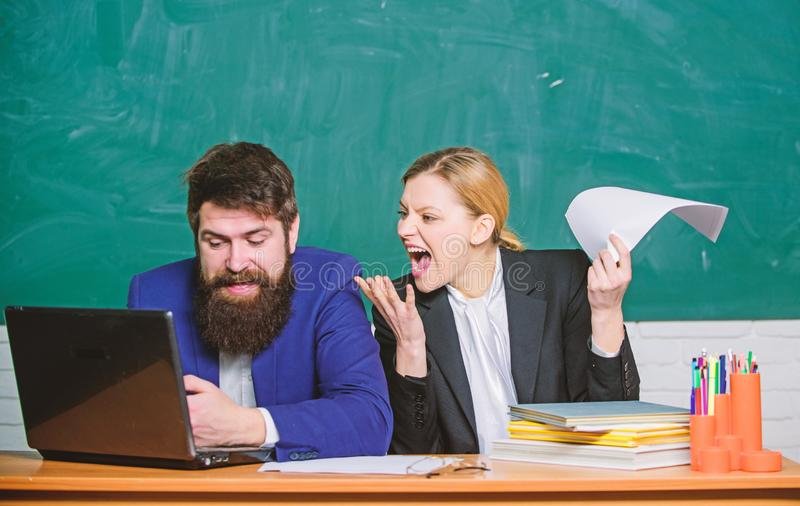 Paper work. office life. back to school. Informal education. business couple use laptop and documents. teacher and. Student on exam. businessman and angry royalty free stock photo