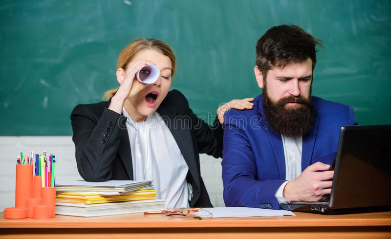 Paper work. office life. back to school. Non-formal education. teacher and student on exam. businessman and secretary. Business couple use laptop and documents royalty free stock photography