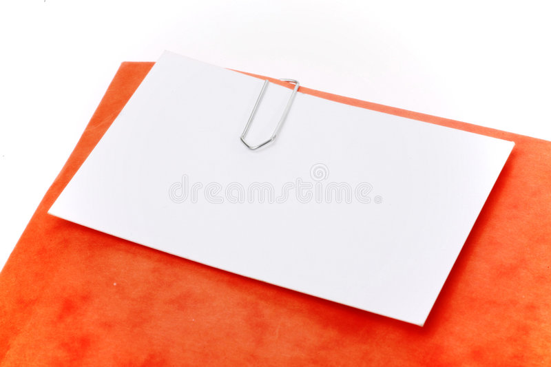 Paperclip. Attachment holding by a paperclip stock photography