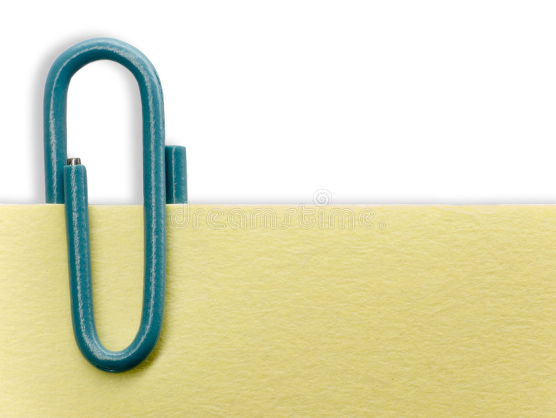 Paperclip on a note. And a white background stock images