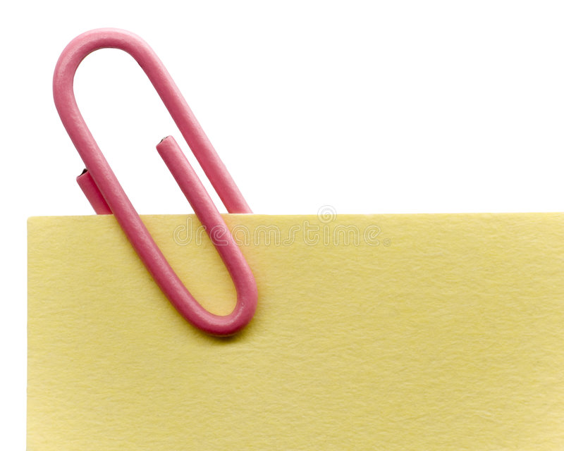 Paperclip on a note. And a white background royalty free stock photo