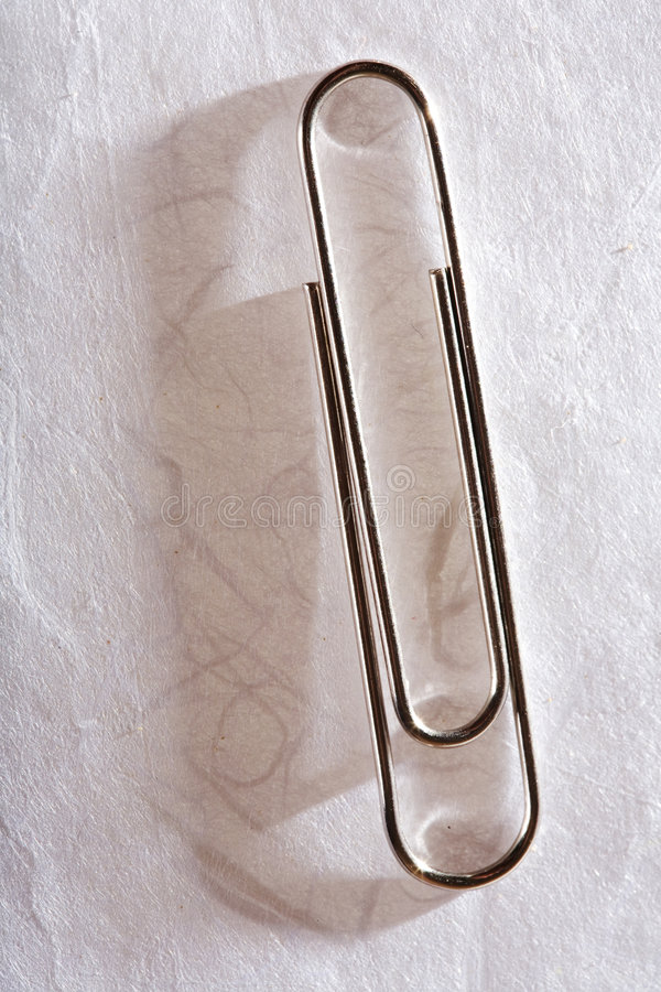 Paperclip On Paper Royalty Free Stock Images