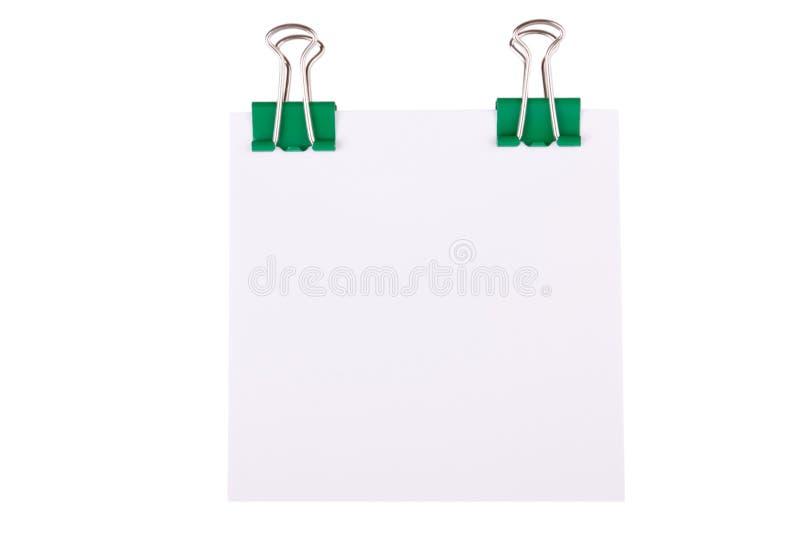 Paperclip verde com papel de nota foto de stock