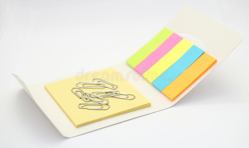 Paperclips with colorful notepads. Necessary equipment for office and school stock image