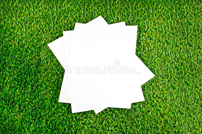 Papers on beautiful green grass background royalty free stock image