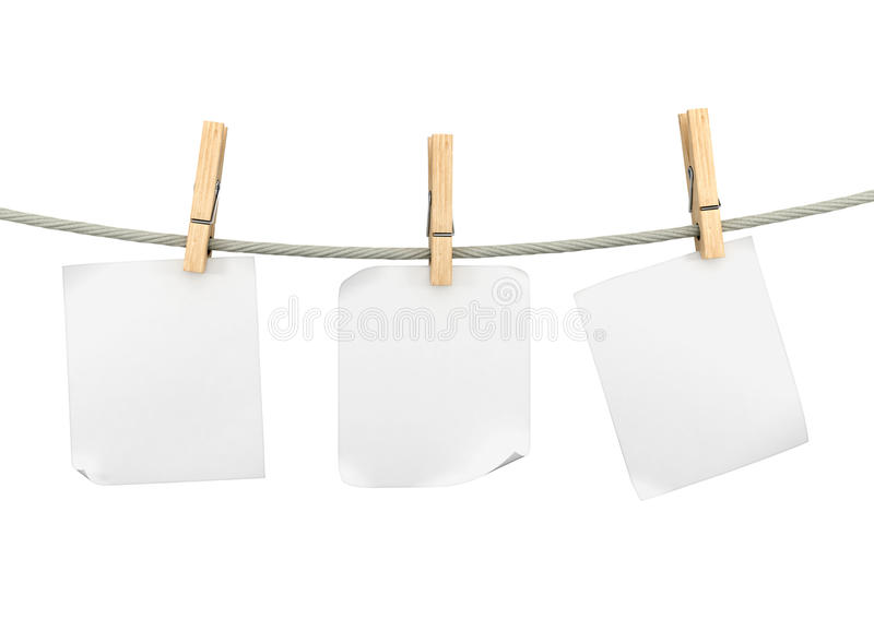 Papers pages on a rope with clothespins royalty free stock images