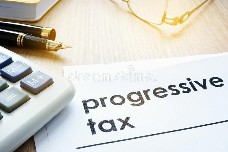 Papers about progressive tax on a desk. Papers about progressive tax on an office desk royalty free stock photos