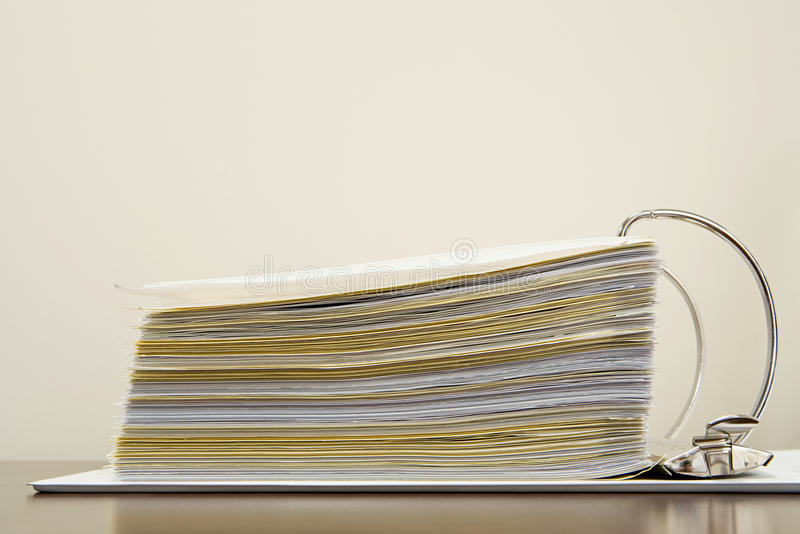 Papers in a ring binder stock image