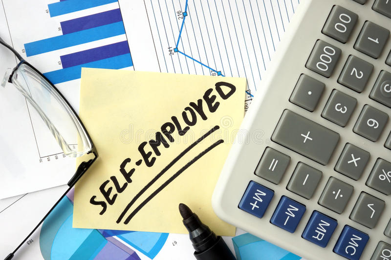 Papers with word self-employed. Papers with graphs and word self-employed royalty free stock images