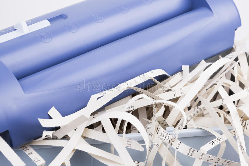 Papershredder with overstaff basket. Image shows a fully basket of a shredder stock images