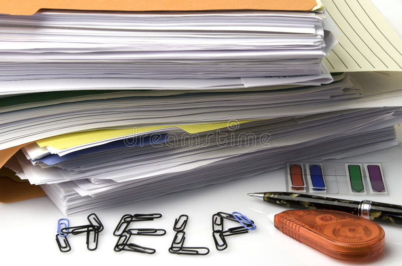 Paperwork. Stacks of paperwork and files on white background with writing pen, correction tape, arrows, and paper clips spelling out the word HELP stock photography