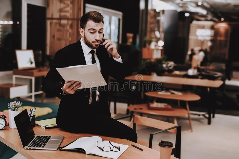 Paperwork. Business Suit. Look. Talking on Phone royalty free stock photo