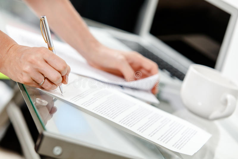 Paperwork. Close-up of secretary's hands doing paperwork royalty free stock photos