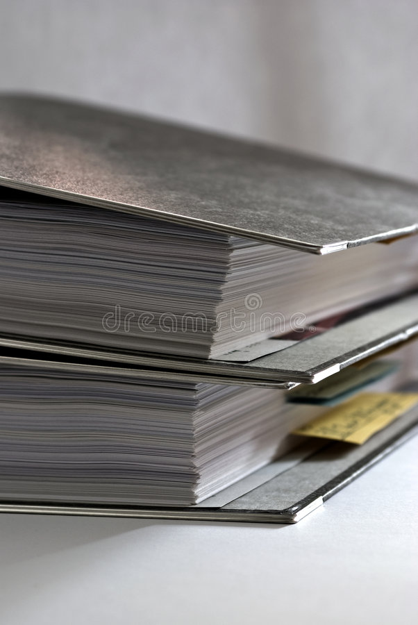 Paperwork - Folders 2. Paperwork in 2 folders neutral background stock photography