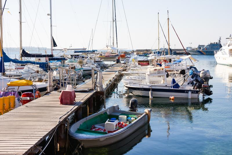 PAPHOS,CYPRUS - July 12, 2017: Boats and yachts at Paphos harbor in the morning stock images