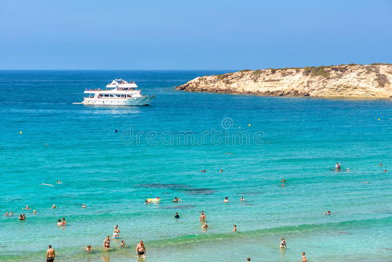 PAPHOS, CYPRUS - JULY 24, 2016: Recreational boat with tourists at Coral Bay Beach.  royalty free stock photo