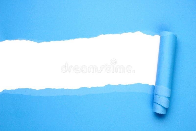 Papier bleu déchiré photo stock