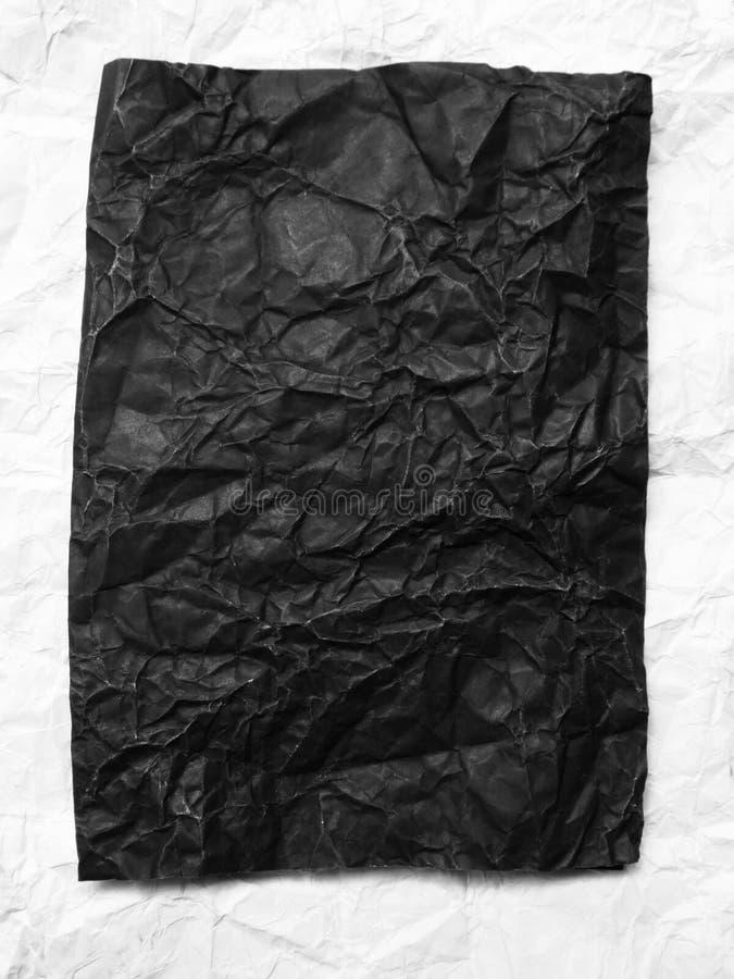 papier chiffonné par noir photos stock