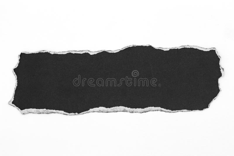 papier déchiré par noir d'isolement sur le fond blanc photographie stock libre de droits