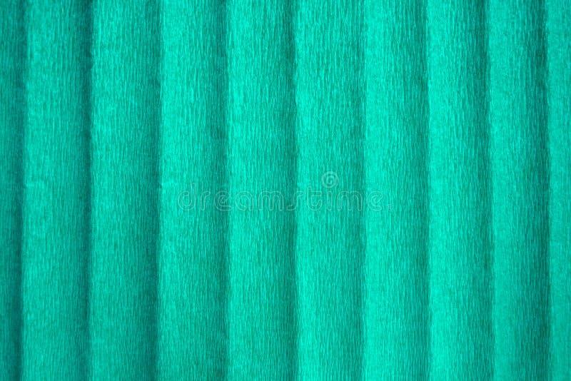 Papier de crêpe bleu avec des plis, fond texturisé abstrait photo stock