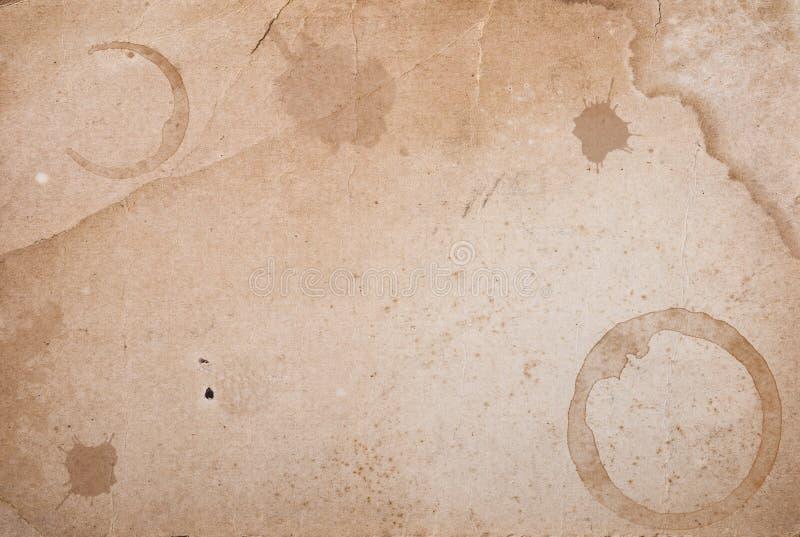 Papier de cru avec la souillure de boucles de café. photos libres de droits