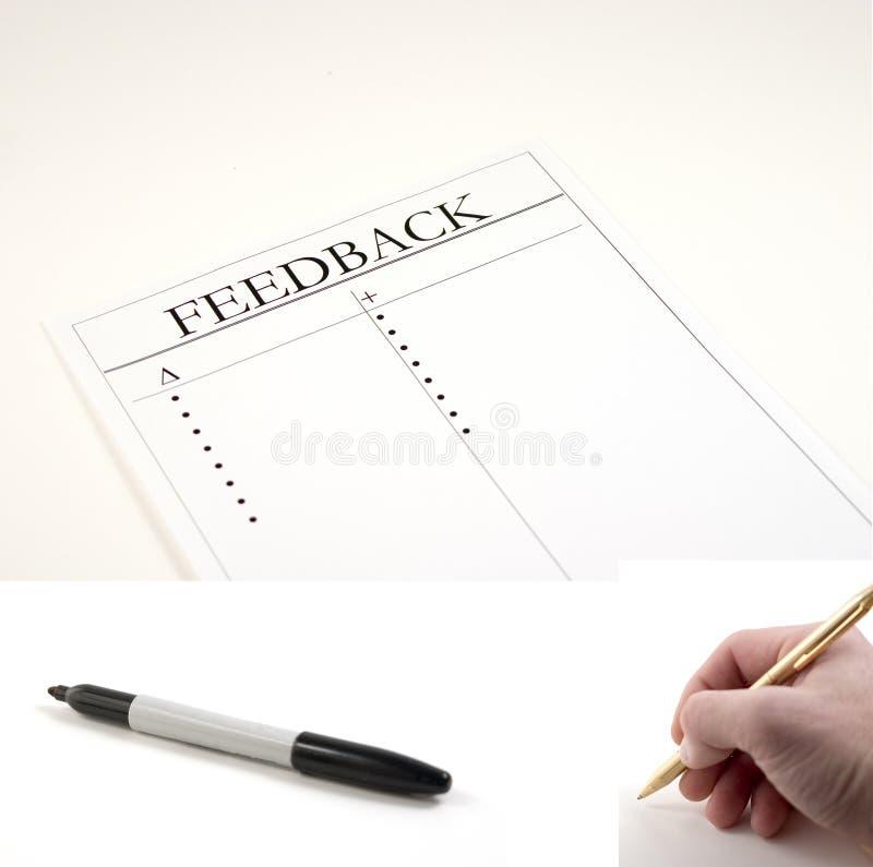 Papier de feedback - (repère et main avec le crayon lecteur compris pour être collé photographie stock libre de droits