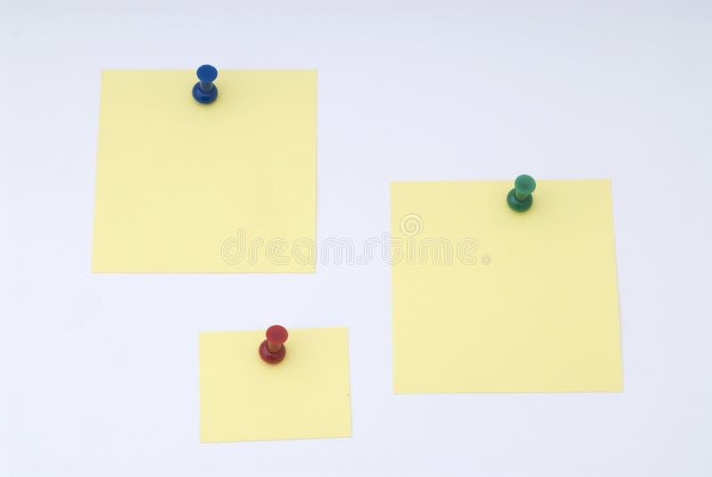 Papier de note jaune avec la pointe photo stock
