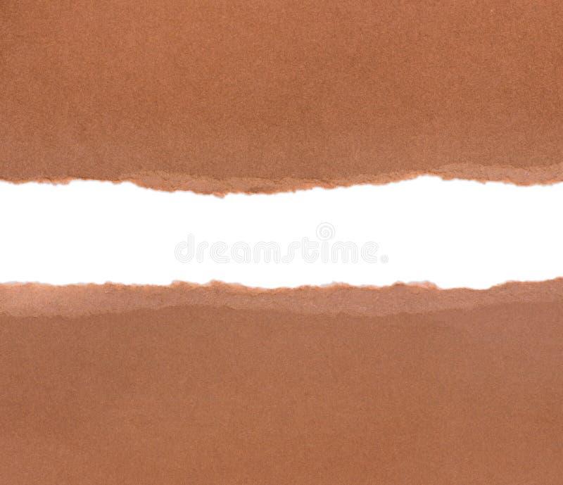 Papier de paquet de Brown déchiré pour indiquer l'idéal blanc de panneau pour le PS de copie image stock