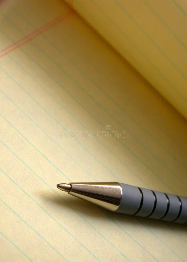 Papier et crayon lecteur photographie stock libre de droits
