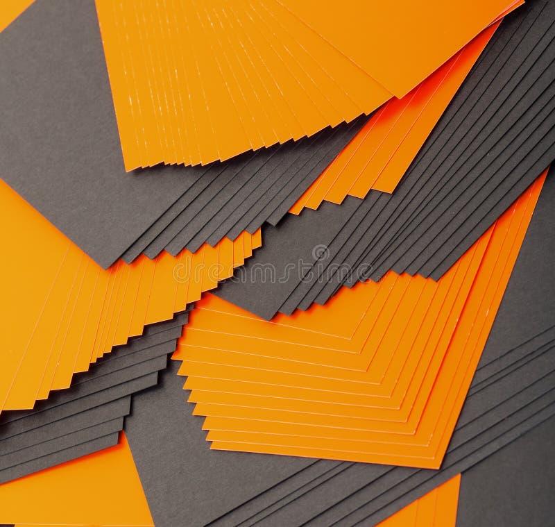 Papier noir et orange de feuilles images libres de droits
