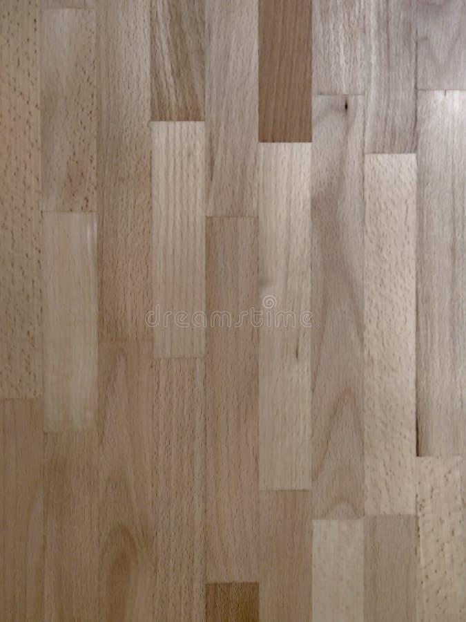 Papier peint en bois brun stratifié comme un bloc que l'on peut trouver sur la table, sur le sol, les portes ou le mur photo libre de droits