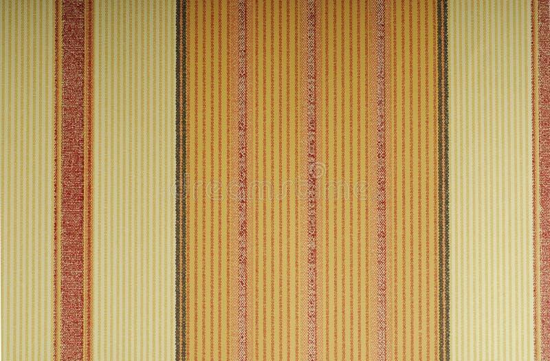 Papier peint orange avec les lignes verticales photographie stock