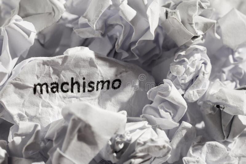 Papier pisać machismo, portuguese i hiszpańskiego słowo dla chauvism, obraz stock