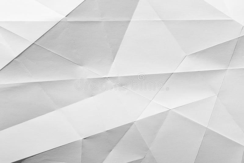 Papier plié par blanc images stock
