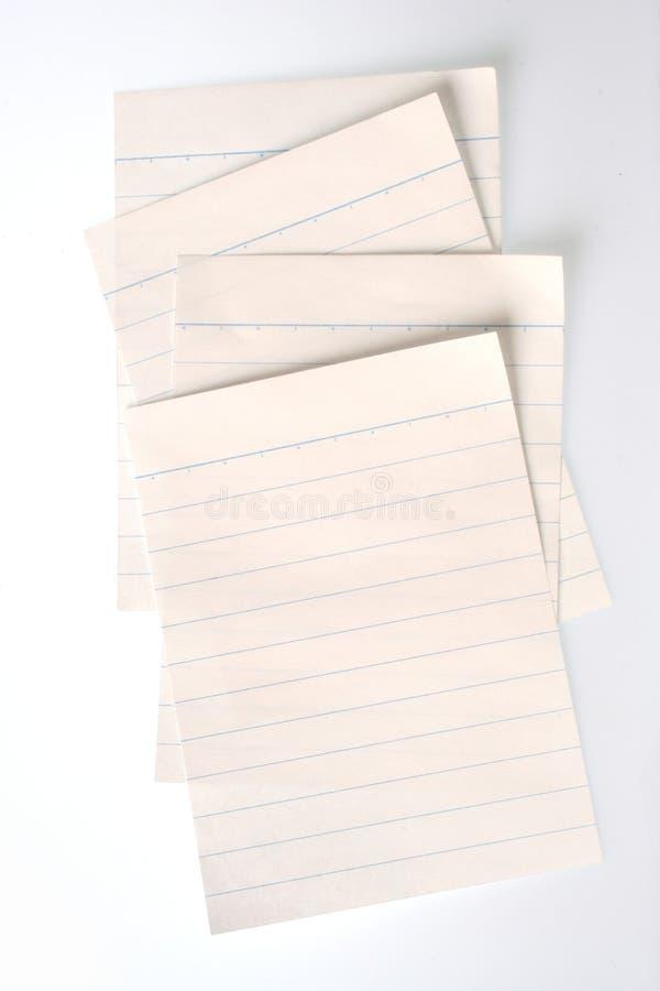 Papier rayé de cahier (avec des chemins de découpage) photographie stock libre de droits
