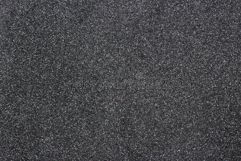 Papierbeschaffenheitshintergrund des noch dunklen Schwarzen mit offenbar ausführlichem natürlichem Korngeräusch-Beschaffenheitsef stockfotografie