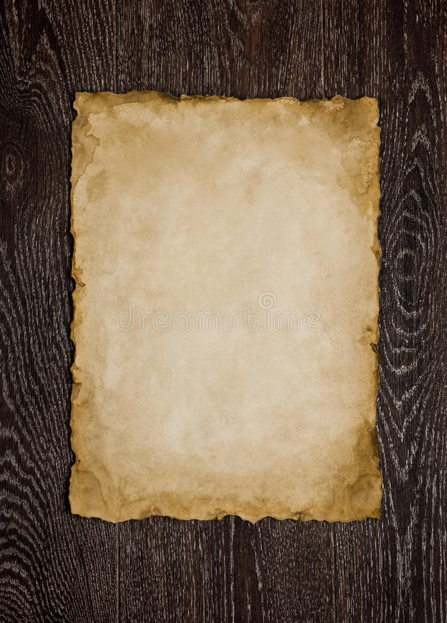Papierblatt auf braunem Hintergrund lizenzfreie stockbilder