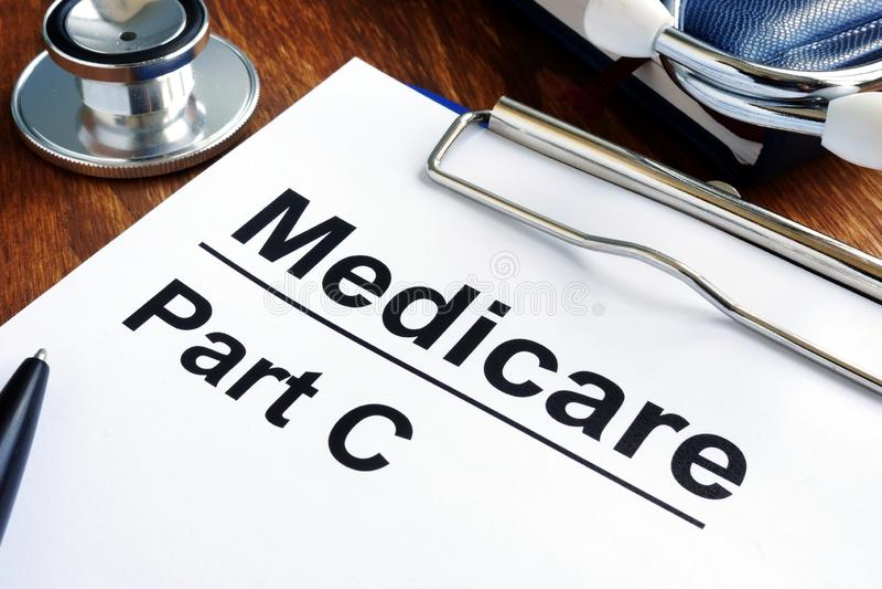 Papiere und Stethoskop Medicare-Teils C stockfoto