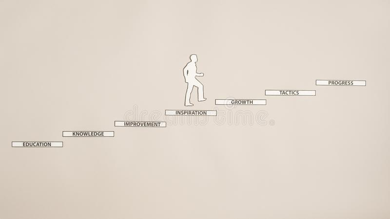 Papierowa sylwetki wycinanka mężczyzna wspina się schodki z readin obrazy royalty free
