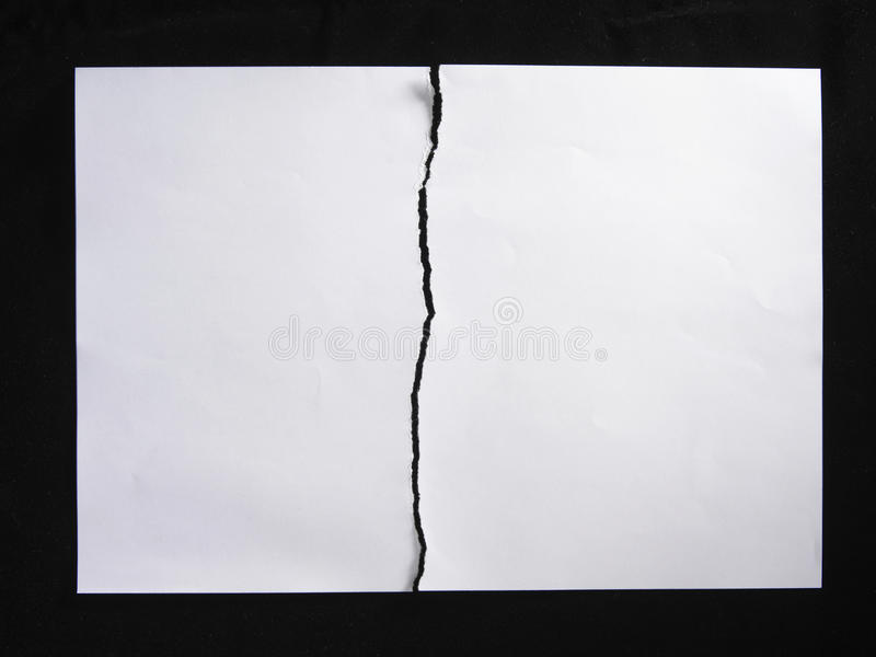 Papierriß zur Hälfte lizenzfreie stockfotos