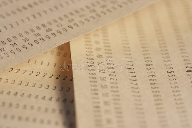 Papiers avec des nombres photos stock