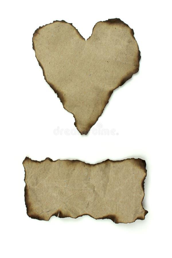 Papiers normaux brûlés de bords images stock