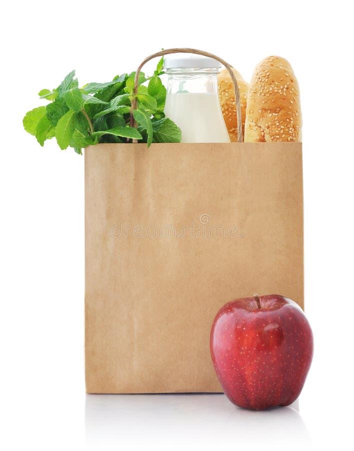 Papiertüte mit Lebensmittel lizenzfreie stockfotografie