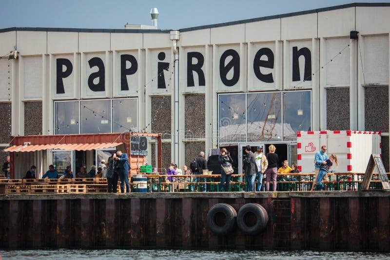 Papiroen or Paper Island in Copenhagen, Denmark. Copenhagen, Denmark - July 29, 2015: People enjoying a summer day at the Paper Island. Papiroen, or Paper Island stock image