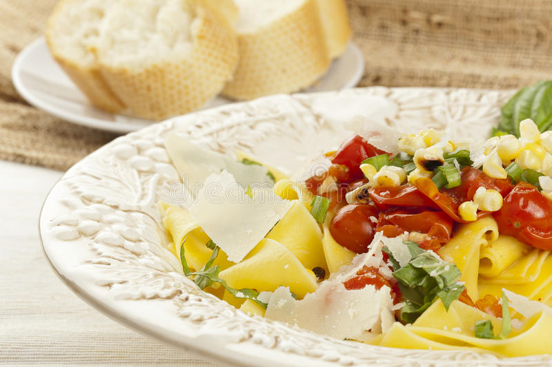 Pappardelle Pasta with corn and tomatoes stock photography
