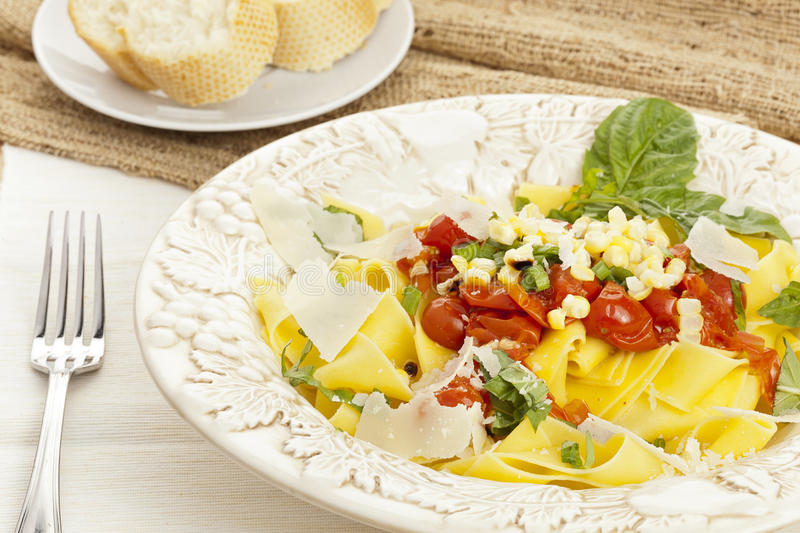 Pappardelle Pasta with corn and tomatoes royalty free stock photo